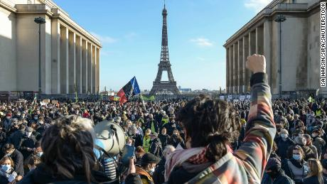 Parisians are protesting against a security bill near the Eiffel Tower on Monday.