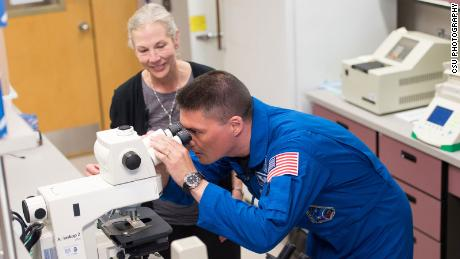 Colorado State University professor Susan Bailey and NASA astronaut Kjell Lindgren are pictured during a visit to Bailey's lab in 2016.
