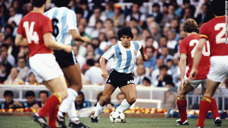 Maradona takes on the Belguim defence during the 1982 World Cup.