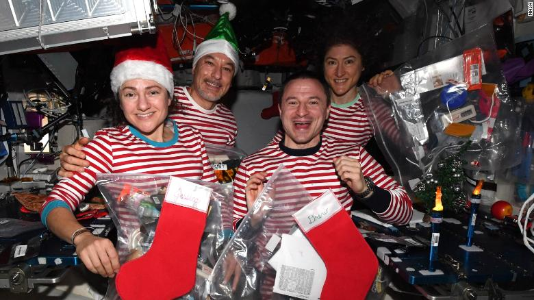 Meir, Parmitano, Morgan and Koch (left to right) celebrate Christmas in space -- in matching pajamas.