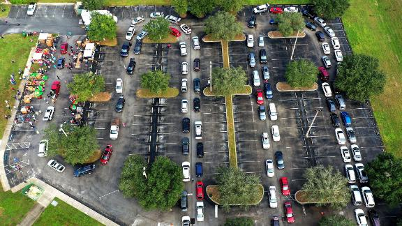 Vehicles line up for food distribution in Clermont, Florida, on November 21.
