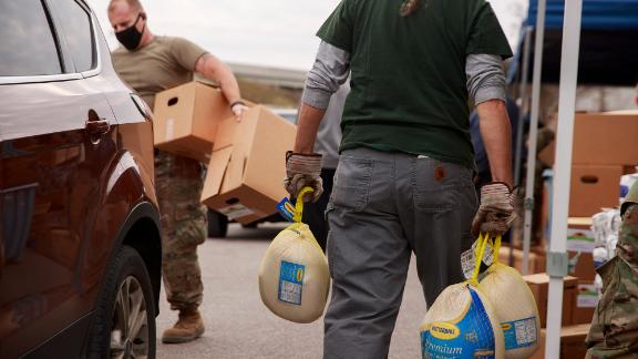 Members of the Indiana National Guard assist food bank volunteers as they distribute Thanksgiving meals in Bloomington, Indiana, on November 20.