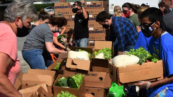 Volunteers distribute turkeys and other foods in Clermont, Florida.