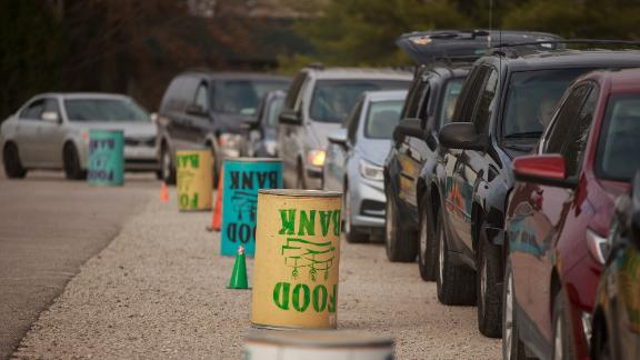 Cars line up as the Pantry 279 food bank hands out Thanksgiving meals in Bloomington, Indiana.
