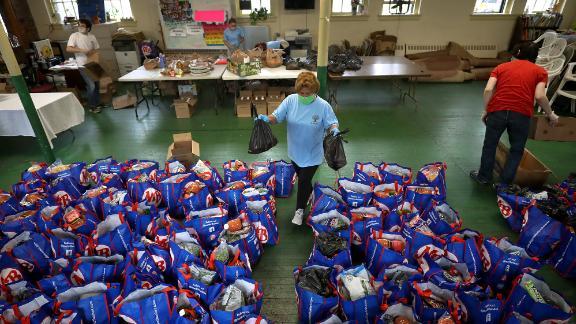Paulina Bastidas-Yale helps distribute food at a Boston church in September.