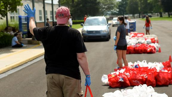 Volunteer Joseph Cunliffe holds a bag of bread to put in someone's car in Robesonia, Pennsylvania, in August.