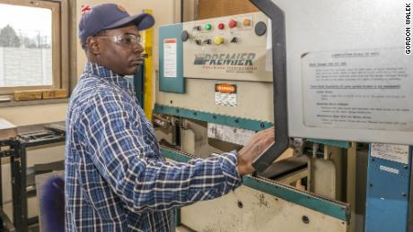 A Jane Allen Resource Corporation career trainee learns how to operate a press brake machine at the group's  Ravenswood training center in Chicago October of 2017.