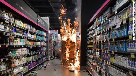 Products burn at a supermarket Carrefour in Sao Paulo, Brazil, on November 20, 2020 on Black Consciousness Day during a protest against racism.