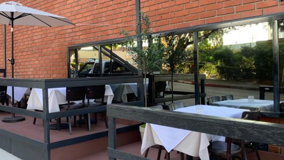 Tables are set up outside Toscana.