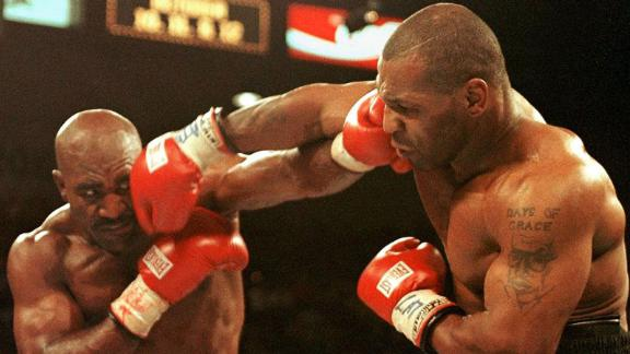 Evander Holyfield (L) and Mike Tyson (R) trade punches on June 28, 1997 in their WBA heavyweight Championship fight at the MGM Grand Garden Arena in Las Vegas.