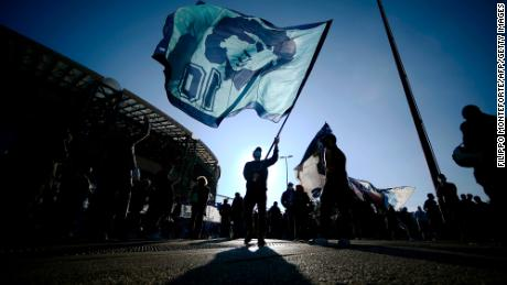 People gather outside the San Paolo stadium in Naples to mourn the death of Maradona.