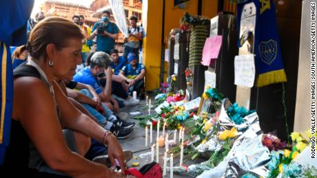 Mourners and fans of Boca Juniors gather at La Bombonera Stadium to pay tribute to Diego Maradona.