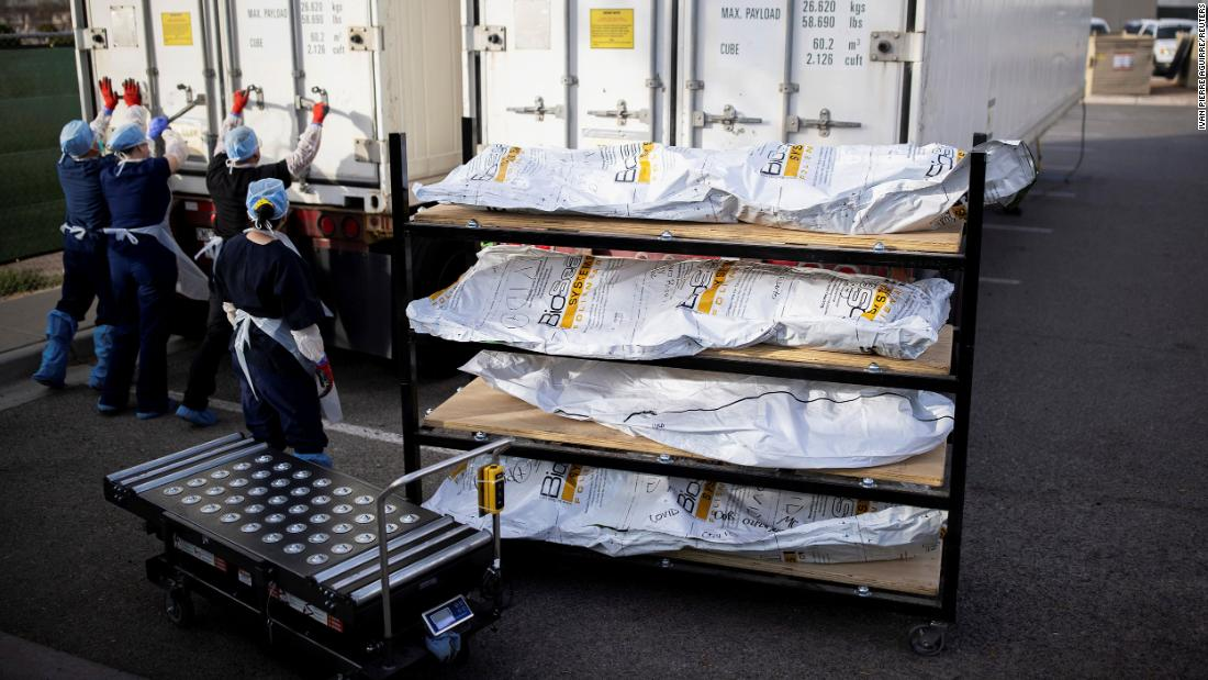 "Workers in El Paso, Texas, move coronavirus victims from refrigerated trailers into the main morgue on November 23. El Paso County had seen a surge in coronavirus cases, and <a href=""https://www.cnn.com/2020/11/16/us/el-paso-inmate-covid-bodies-trnd/index.html"" target=""_blank"">inmates were recruited to help the shorthanded, overworked staff. </a>"