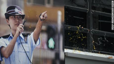 A poster of a policewoman is seen as protesters throw eggs and bricks outside a police station in the Tseung Kwan O district in Hong Kong on August 4, 2019.