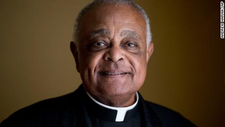 FILE - This Sunday, June 2, 2019, file photo shows Washington D.C. Archbishop Wilton Gregory posed for a portrait following mass at St. Augustine Church in Washington. Gregory, who is undergoing quarantine at the Santa Marta hotel before Saturday's consistory, said that while he was unable to go out, at least he was able to get his new red cassock delivered from Rome's famous clerical haberdasher, Gammarelli. (AP Photo/Andrew Harnik, File)