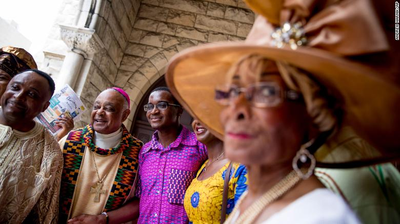 Gregory, second from left, greets parishioners following mass at St. Augustine Church in Washington on June 2, 2019.