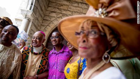 Archbishop Wilton Gregory greeted the parishioners after his second Mass from the left on June 2, 2019, at St. Augustine's Church in Washington.