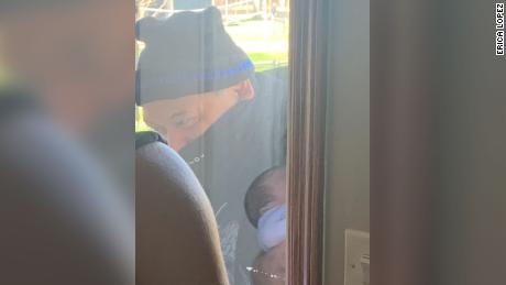 Lopez visits his youngest grandchild for the first time, through a window, because of concerns over Covid-19.