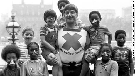 Dave Prowse in his role as the Green Cross Code Man, with students from Lambeth Johanna Primary School in London.