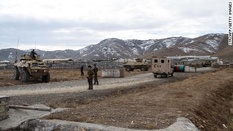 Security personnel patrol after a car bomb struck an army base on the outskirts of Ghazni province on November 29, 2020.