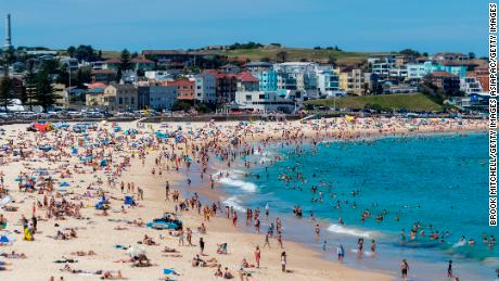 People gather at Bondi beach in Sydney, Australia on Saturday as temperatures soar past 40 degrees Celsius (104 degrees Fahrenheit).