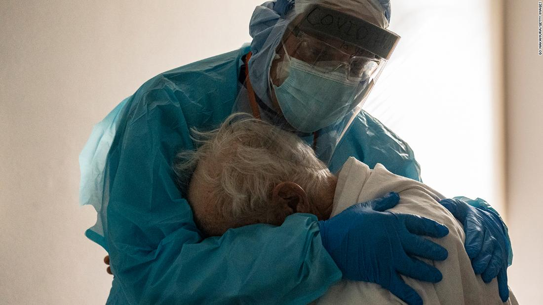 Doctor comforting elderly patient in heartbreaking photo speaks to CNN