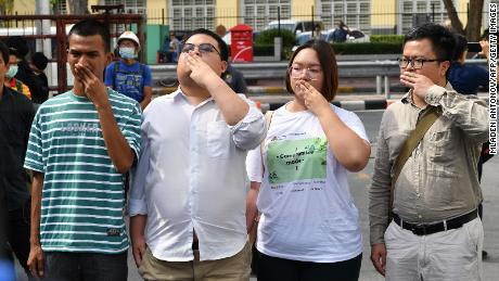 """Pro-democracy activists Panupong """"Mike"""" Jadnok, Parit """"Penguin"""" Chiwarak, Panusaya """"Rung"""" Sithijirawattanakul and Arnon Nampa at Chanasongkram police station in Bangkok on November 30, 2020."""