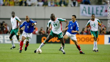 Diop playing in Senegal's shock victory over France at the 2002 World Cup.
