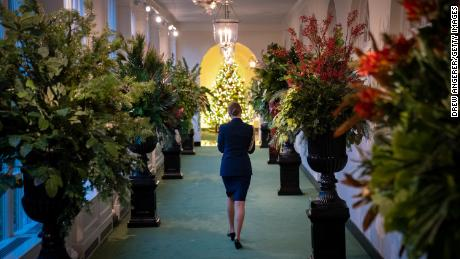 A military aide walks through the East Colonnade as it is decorated for Christmas at the White House on November 30, 2020.