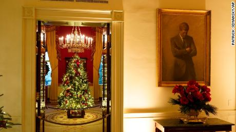 The White House's Red Room is decorated during the 2020 Christmas preview, Monday, November 30, 2020, in Washington.