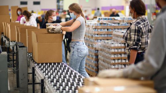 Volunteers in Denver work at the Food Bank of the Rockies on November 25.