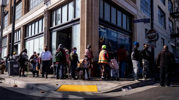 Hundreds of homeless people wait in line to receive food from the Los Angeles Mission on the day before Thanksgiving.