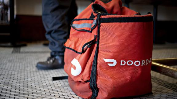 A DoorDash Inc. delivery bag sits on the floor at Chef Geoff's restaurant in Washington, D.C., U.S., on Thursday, March 26, 2020. As the wheels of government turn too slowly for small businesses desperate for a piece of the $2 trillion U.S. relief package due to the coronavirus pandemic, restaurateur Geoff Tracy is using GoFundMe to raise money for 150 hourly workers at his American comfort food standby Chef Geoff's and other restaurants. Photographer: Andrew Harrer/Bloomberg via Getty Images