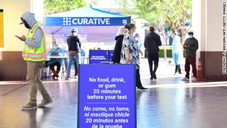 A sign reminds people of dietary procedures ahead of their coronavirus test at Union Station in Los Angeles, California on November 13, 2020. - Having passed 1 million COVID-19 cases as infections across the country increase, California is joining the states of Oregon and Washington in urging travellers to self quarantine to help slow the spread of the coronavirus ahead of the nation's Thanksgiving and Christmas holiday seasons. (Photo by Frederic J. BROWN / AFP) (Photo by FREDERIC J. BROWN/AFP via Getty Images)