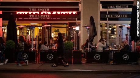 Restaurants and bars in New York, like The Smith, shown above on Thanksgiving day, are among those in a number of states required to close early amid new coronavirus restrictions.