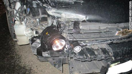 A driver in Washington was pulled over after police noticed the headlights on his car had been replaced by flashlights.