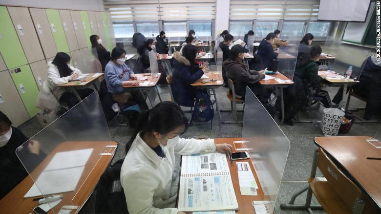 Half a million South Korean students sit a college entrance exam despite rising Covid cases