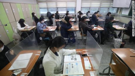 South Korean students take their college entrance exam at a school amid the coronavirus pandemic on December 3, 2020 in Seoul, South Korea.