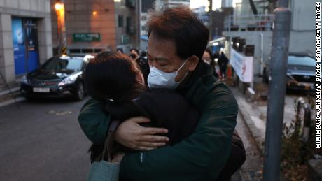 On December 3, 2020, in Seoul, South Korea, amid a coronovirus epidemic, a father stops his daughter from giving her college entrance exam.