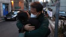 A father hugs on her daughter taking the college entrance exam amid the coronavirus pandemic on December 3, 2020 in Seoul, South Korea.