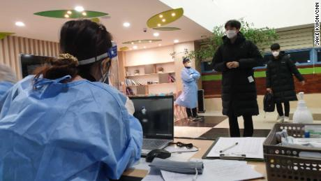 Students prepare to take their college entrance exam with special coronavirus precautions at Dosun High School in Seoul, South Korea on December 3, 2020.