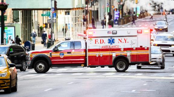 NEW YORK, NEW YORK - MAY 20: An FDNY ambulance drives on Fifth Avenue during the coronavirus pandemic on May 20, 2020 in New York City. COVID-19 has spread to most countries around the world, claiming over 329,000 lives with over 5 million infections reported.  (Photo by Noam Galai/Getty Images)