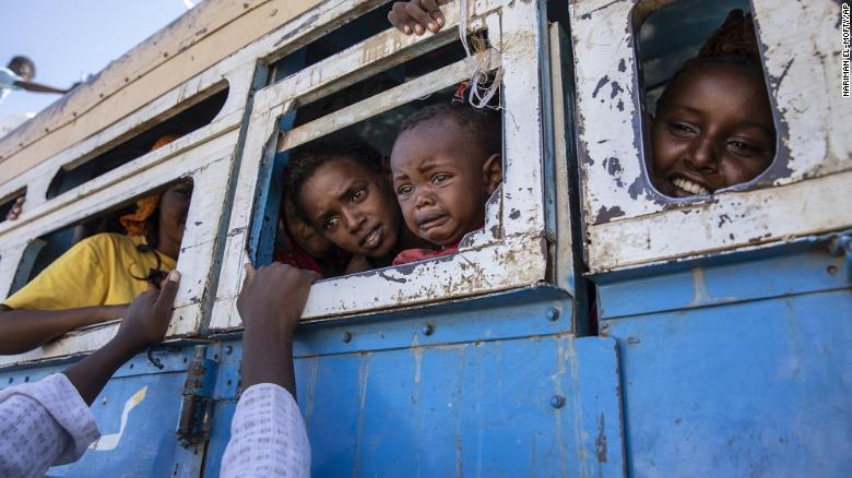 Tigray refugees who fled the conflict in northern Ethiopia ride a bus to a temporary shelter near the Sudan-Ethiopia border on Tuesday, December 1.