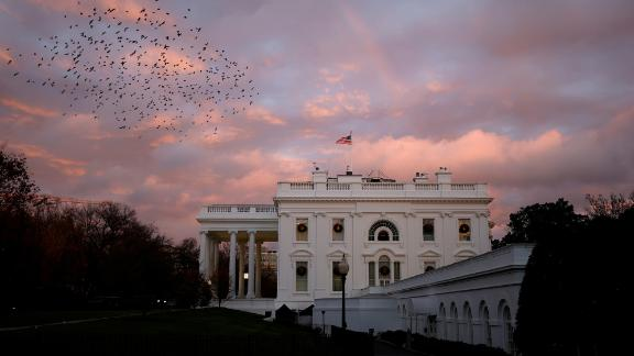 A rainbow appears over the White House as birds fly nearby following a storm in Washington, U.S., November 30, 2020. REUTERS/Tom Brenner     TPX IMAGES OF THE DAY