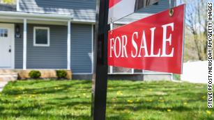 "A ""for sale"" sign in front of a home in Wyandanch, New York, on April 22, 2020."
