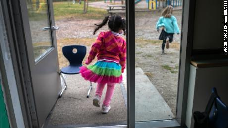Kindergarten students race outside for a break in Stamford, Connecticut. The social and emotional learning at school is key as is academic growth.