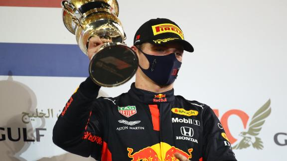 Red Bull's Dutch driver Max Verstappen celebrates with his 2nd-place trophy on the podium after the Bahrain Formula One Grand Prix at the Bahrain International Circuit in the city of Sakhir on November 29, 2020. - Lewis Hamilton powered to victory at the Bahrain Grand Prix on Sunday in a race overshadowed by a horrific crash for French driver Romain Grosjean. (Photo by Bryn Lennon / POOL / AFP) (Photo by BRYN LENNON/POOL/AFP via Getty Images)