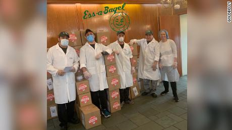 Employees of Ess-a-Bagel posing for a photo early on in the pandemic with Goldbelly boxes.