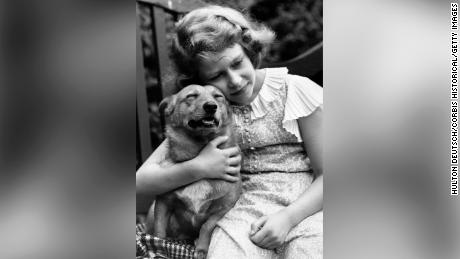 Princess Elizabeth, aged 10, pictured here with one of her dogs