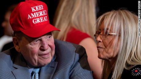 Sheldon Adelson (L), CEO and president of Las Vegas Sands casino company, listens as U.S. President Donald Trump makes remarks at the Keep America Great demonstration in Las Vegas, Nevada, on February 21, 2020.